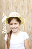 Smiling little girl with a hat Stock Photography
