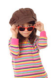 Smiling little girl in hat and sunglasses Stock Photo