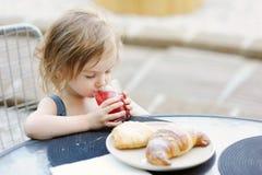 Smiling little girl having breakfast Royalty Free Stock Photos