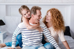 Smiling little girl having fun with her grandparents Royalty Free Stock Photo