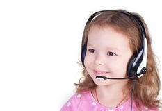 Smiling little girl in headset Royalty Free Stock Photography