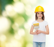 Smiling little girl in helmet with paint brush Royalty Free Stock Photo