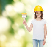 Smiling little girl in helmet with paint brush Stock Photography