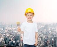 Smiling little girl in helmet with paint brush Stock Images