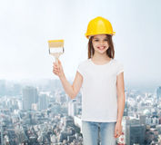Smiling little girl in helmet with paint brush Royalty Free Stock Photos