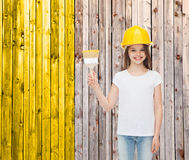 Smiling little girl in helmet with paint brush Royalty Free Stock Images