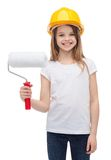 Smiling little girl in helmet with paint roller Royalty Free Stock Photos