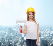 Smiling little girl in helmet with paint roller Royalty Free Stock Photo