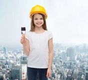 Smiling little girl in helmet with paint roller Stock Photos