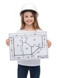 Smiling little girl in helmet showing blueprint Royalty Free Stock Photography