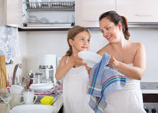 Smiling little girl helping mother Stock Image
