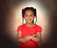 Smiling little girl with her crossed arms Stock Images