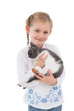 Smiling little girl with her cute kitten Royalty Free Stock Photo