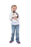 Smiling little girl with her cute kitten Stock Images