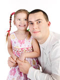 Smiling little girl with her father isolated Royalty Free Stock Image