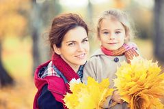 Mother and daughter in the autumn park Stock Images