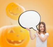 Smiling little girl holding big white text bubble Royalty Free Stock Photo
