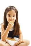 Smiling little girl holding a bowl with cookie or biscuit Royalty Free Stock Photo