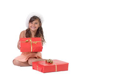 Smiling little girl is holding Christmas gift Stock Photography