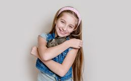 Smiling little girl holding a degu on her arms Royalty Free Stock Images