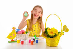 Smiling little girl holding an Easter egg Stock Photos