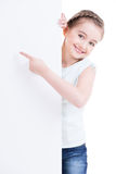 Smiling little girl holding empty white banner. Royalty Free Stock Photo