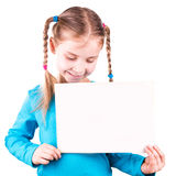 Smiling little girl holding white card for you sample text Royalty Free Stock Image