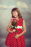 Smiling little girl holding flowers Royalty Free Stock Photos