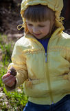 Smiling little girl holding garden snail Stock Photos