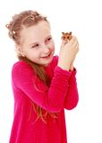 Smiling little girl holding hands in front of a. Hamster.Isolated on white background Royalty Free Stock Images