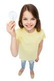 Smiling little girl holding light bulb Stock Images