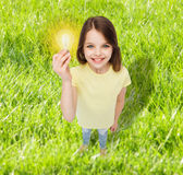 Smiling little girl holding light bulb Stock Photography