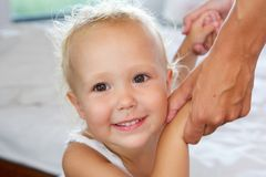 Smiling little girl holding mother hands Stock Photos