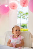 Smiling Little Girl Holding Paper Pink Cup Royalty Free Stock Image