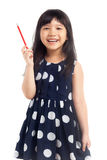 Smiling little girl holding pencil Stock Images