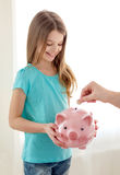 Smiling little girl holding piggy bank Stock Image
