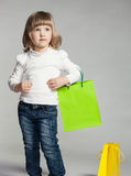 Smiling little girl holding shopping bag Royalty Free Stock Photography