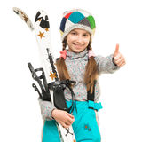 Smiling little girl holding skis with thimb up Royalty Free Stock Photo