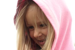 Smiling little girl in a hood. Smilling little girl in a pink hood stock photos