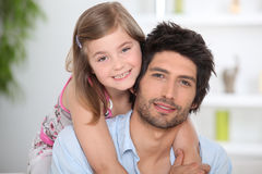 Smiling little girl hugging young man Royalty Free Stock Photos