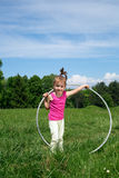 Smiling Little Girl With Hula Hoop Enjoying Beautiful Spring Day In The Park Stock Photos