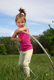 Smiling Little Girl With Hula Hoop Enjoying Beautiful Spring Day In The Park Stock Image