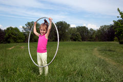 Smiling Little Girl With Hula Hoop Enjoying Beautiful Spring Day In The Park Royalty Free Stock Photos