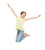 Smiling little girl jumping stock images