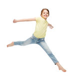 Smiling little girl jumping Stock Image