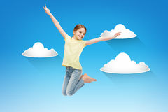 Smiling little girl jumping Stock Photos