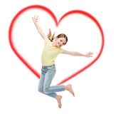 Smiling little girl jumping. Happiness, activity and child concept - smiling little girl jumping Royalty Free Stock Image