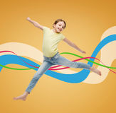 Smiling little girl jumping Royalty Free Stock Photos