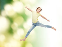 Smiling little girl jumping Royalty Free Stock Images