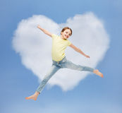 Smiling little girl jumping. Happiness, activity and child concept - smiling little girl jumping Stock Images
